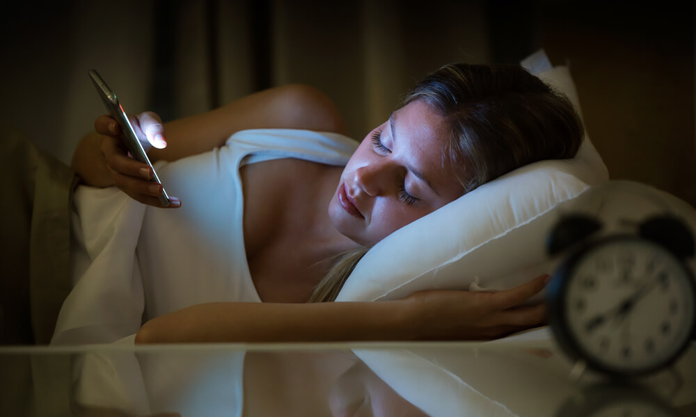 woman asleep while using phone